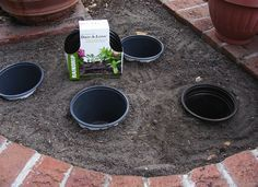 Place plastic pots directly into landscaping beds. Then, drop seasonal plants—pot and all—right into the hole. When the blooms fade or the season changes, remove the old pot and switch in a new plant. Be sure to choose pots with adequate drainage holes.