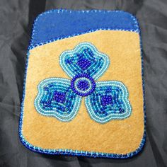 card holder pattern | Moose Hide Card Holder with Blue Beaded Flower Design | Arctic Canada ... Native American Crafts, Native American Beading, Business Card Case, Business Card Holders, Beaded Flowers, Blue Flowers, Beading Patterns, Beading Ideas, Nativity Crafts