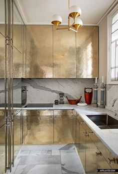 Gold metallic cabinets in the kitchen                                                                                                                                                                                 More