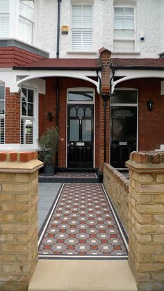 Victorian mosaic tile path granite paving York stone bespoke bike store granite paving metal wrought iron rail topiary hedge Wimbledon London Contact anewgarden for more information Victorian Front Garden, Victorian Front Doors, Victorian Porch, Victorian Terrace House, Outdoor Paving, Outdoor Flooring, Victorian Mosaic Tile, Enclosed Front Porches, Red Brick Exteriors