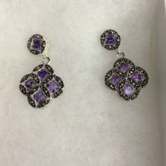 "Purple CZ earrings Purple CZ and marcasite earrings. I think these are in sterling but can't see the markings clearly. Post and butterfly backs. They measure approximately 1"". Jewelry Earrings"