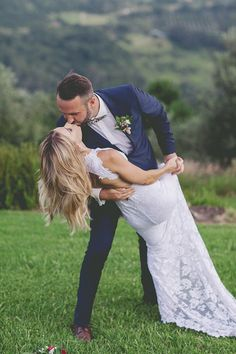 Sweet bride and groom dip kiss portrait | Kat Stanley Photography | See more: http://theweddingplaybook.com/fresh-and-modern-garden-wedding/