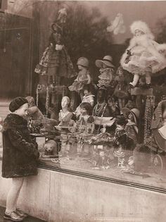 I will take it all please....Store window of a doll shop, 1920s