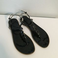 Black sandals Black patent leather sandals with black enamel details. Adjustable ankle strap. Fits true to size. Very little wear, great condition! Old Navy Shoes Sandals