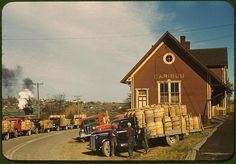 *Trucks outside of a starch factory. Caribou, Aroostook County, Maine, October 1940. Reproduction from color slide. Photo by Jack Delano. Prints and Photographs Division, Library of Congress