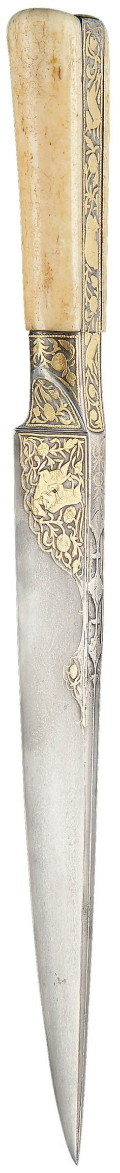 Persian (Zand or Qajar) kard dagger, late 18th to early 19th century, tapering single-edged watered-steel blade, the back edge engraved with a central ridge and lobed medallions, the forte and hilt with hunting scenes and chasing animals in foliage, the signature in gold on the blade ('Ali Akbar), walrus ivory hilt, 15 3/8in. (39cm.) long.