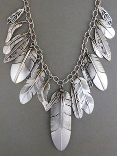 Sterling Silver Feather Necklace from Southwest Silver Gallery http://www.southwestsilvergallery.com/AWSCategories/p/408/Lena-Platero-Silver-Feather-Jewelry