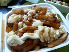 """Poutine: """"French Canadian dish, made with french fries, topped with brown gravy and curd cheese. International chains like KFC, and Burger also sell mass-produced poutine in Canada. Canadian Dishes, Canadian Cuisine, Canadian Food, Canadian Poutine, Canadian French, Canadian Recipes, Canadian Things, French Fries With Cheese, Cheddar"""