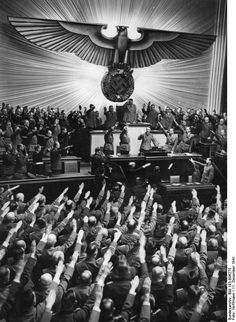 Adolf Hitler receiving salutes from the German Reichstag upon declaring war on the United States, Berlin, Germany, 11 Dec 1941 Photographer Heinrich Hoffmann Source German Federal Archive