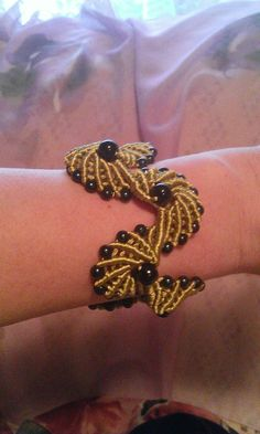 A beautiful macrame bracelet decorated with beads. This bracelet is made with knots according to the art of macrame.I used polyester waxed cord but