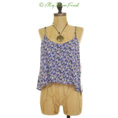 Mimi Chica Crop Swing Blue Floral Cami Hi Low Top Please ask if item is still available. Style: Cami Stretch: No Closure: None Lining: No Weight: Thin weight.  Size: Large Length: 21 in. Bust: 38 in. Waist: 44 in. Sleeve: n/a  --->All measurements are taken with the garment lying flat,  and photos may be taken with clipping and/or pinning.  Condition: New with tags   Item is new with tags attached.  Materials/Color   Cotton. Machine wash cold. The color is multi (floral). Mimi Chica Tops…