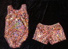 6-8a girls size Ready to ship Gymnastics Leotard and short set in pink w/orange and black leopard holographic print, this is a longer body