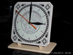 Desk clock made of 5 mm thick, classic white Lacobel glass.  Size 15 cm by 15 cm.