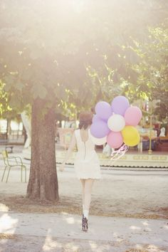 Pretty white dress. And balloons.