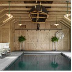 Indoor pool - rustic interior with clean, modern pool. Love the contrast and simplicity!