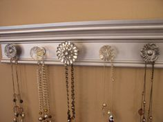 Stunning metallic jewelry organizer . This necklace holder wall hung rack features rhinestone center 5 knobs total 15 inches long $32.00