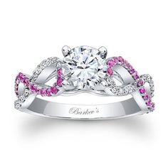 White Gold Round White and Pink Sapphire Diamond Engagement Ring - Vibrant colors makes this two toned masterpiece excellent with this White Gold Round White and Pink Sapphire Diamond Engagement Ring stamped in 14k White Gold in a Prong setting featuring a White Round cut center stone with White and Pink Round accent stones on the twist shank. The White Gold Round White and Pink Sapphire Diamond Engagement Ring has a weight of .50 carats, SI1 in clarity and F-G in color…
