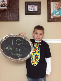 100 days of school TShirt idea. glued 100 Pom Poms in shape of a tie..it was perfect!