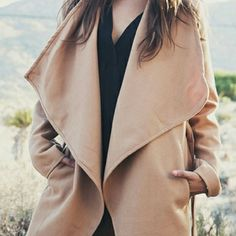 "Turn Down Collar Coat Camel colored, light weight, chic coat is open front and belted tie waist. No inner Lining.. Length 36""Bust 39 1/2 "" Sleeve 24 1/4"" Material Polyester Boutique Jackets & Coats Trench Coats"