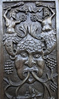 Green Man with mermen coming out of his ears on a 16th Century bench end in the Church of the Holy Ghost, Crowcombe, Devon, England (photo Rex Harris
