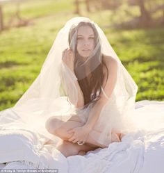 Demure: Brides-to-be posing in lingerie for professional photos as a gift for future husbands.