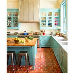 via Sawyer|Berson - terra cotta hex floors and colored cabinets.  LUV