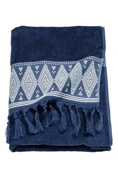 Hand towel in soft cotton terry with an embroidered pattern and tassels at the bottom. Hanger on one short side.