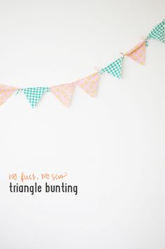 DIY: NO FUSS, NO SEW TRIANGLE BUNTING.  Kind of diaper-shaped.  Maybe okay for a baby shower?  Make more pointy...