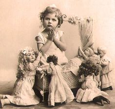 little girl with her dolls