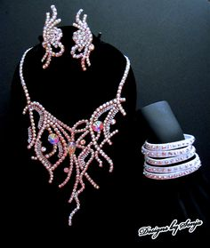 Ballroom jewelry, necklace, earrings and bracelets designed and created by Sonja Ballin. All Jewelry Designs copyright ©2014, Sonja Ballin of Tampa Bay, Florida. www.sonjadesigns.com Check us out  (and like) on Facebook:  https://www.facebook.com/pages/Designs-By-Sonja/220737151285770