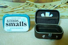 """Miniature leather suitcase from Altoids cases - Supplies Needed:  Altoids smalls tin-2 1/4 x3"""" size  Old leather wallet , tacky glue, black or brown marker, leather cord , peel off metallic sticker from scrapbook aisle."""
