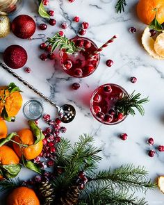Rosemary-Infused Citrus and Cranberry Cocktail Image Via: MyDomaine