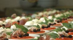 Wedding appetizer - mozzarella with prosciutto, tomatoes, olives and basil on an olive oil. Classic but delicious! weddinx.sk