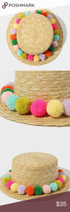 Pom Pom Straw Sun Hat A must have for spring break and summer! A beautiful sun hat with colorful pom poms adorning the brim. Measures 3.75 inches high and brim is 2 inches wide. One size fits all. Made of 100% straw. Atelier Sona Accessories Hats