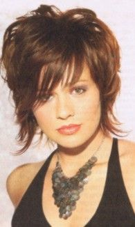 A Brunette with Progressive Layers hairstyle with wispy side swept bangs
