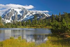 North Cascades National Park - Washington.  504,780.94 acres. This complex includes the two units of the National Park and the Ross Lake and Lake Chelan National Recreation areas.  There are numerous glaciers and popular hiking and climbing areas are Cascade Pass, Mount Shuksan, Mount Triumph and Eldorado Peak.