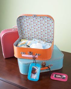 "Neat idea for unique storage for those childhood mementos all us mothers keep. Notice the ""luggage tags"" used to identify the mementos owner!!"
