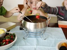 Family Night In: Fondue Party Fun  You do not need to wait for a special occasion to throw an easy and fun fondue party. Any old Monday will do.