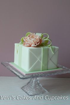 Christmas gift box fondant cake with bow this adorable fondant cube cake gift box cake by vavis cakes cupcakes inspired by pamela mccaffrey made with love cakes negle Images