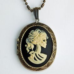 This beautiful retro Lolita Cameo Locketis slightly modern with a farthing of Victorian elegance. Lovingly handmadeand set in a brass base, this female skeleton bust necklace puts a punk rock twist on a classic cameo.Go from casual to chic with this snazzy piece,a quick change of heel and a bold red lip.