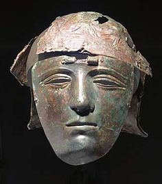 mask helmet of the Kalkriese type. Brass sheet on iron core in combination with remains of a Weiler Type bowl with figural decorations