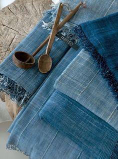 Indigo colored kitchen linen in home interiors. For more indigo colored home textiles, click http://www.suraaj.com/blog/trend-alert-indigo-as-a-statement-color-in-home/