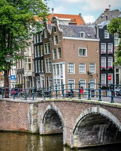 // Okay, Amsterdam pics are served!  Look at how crooked the buildings are!  I guess once a building starts to lean out, you get a little extra space in your home.