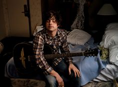 I forgot this used to be my desktop background for years...Ryan Adams, shot by Annie L., and an Indianapolis Motor Speedway sticker. There has never been a more perfect picture.