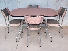 1950s Retro Pink Laminex Kitchen Set..so remember a set like this only ours was a brown table and the chairs were brown and yellow flowered..got this after getting rid of the long table and benches to sit on when I was growing up!!!