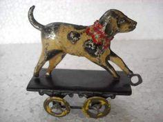 Vintage dog penny tin toy