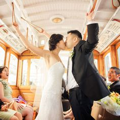A classic San Francisco trolley provided the perfect backdrop for this @Four Seasons Hotel San Francisco couple's smooch.