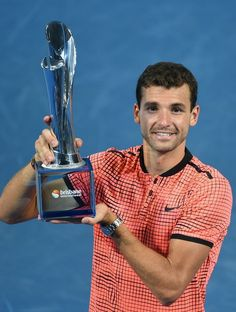 08 JAN 2017: Grigor Dimitrov of Bulgaria lifts his winning trophy after defeating Kei Nishikori Grigor Dimitrov of Bulgaria holds the Roy Emerson trophy after winning  the Men's Final against Kei Nishikori of Japan during day eight of the Brisbane international at Pat Rafter Arena in Brisbane, Australia.
