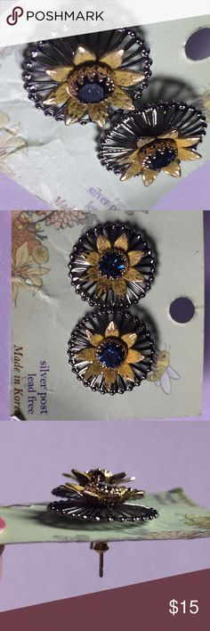 Flower earrings. New women's earrings. Detailed flower with blue studs and yellow metal petals. Jewelry Earrings