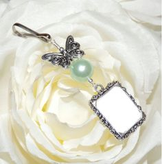 Butterfly and mint green pearl Wedding bouquet photo charm. Bridal bouquet Photo charm with pearl & silver tone butterfly. Gift for a bride by SmilingBlueDog on Etsy Small Picture Frames, Wedding People, Bouquet Charms, Butterfly Wedding, Photo Charms, Star Wedding, Pearl Color, Silver Pearls, Mint Green